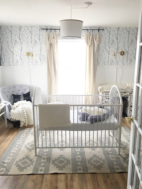 White crib in nursery