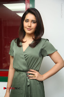 Actress Raashi Khanna Stills in Green Short Dress at Mirchi 95 Suno Aur Mercedes Jeeto Contest  0102.JPG