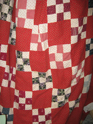 antique red and white nine-patch quilt