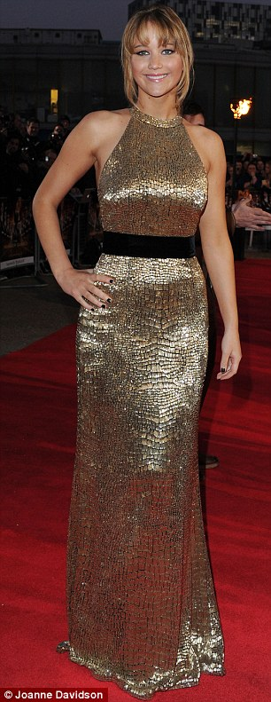 Jennifer Lawrence in a gold Ralph Lauren dress