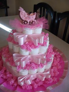 bolo de fralda rosa com laço