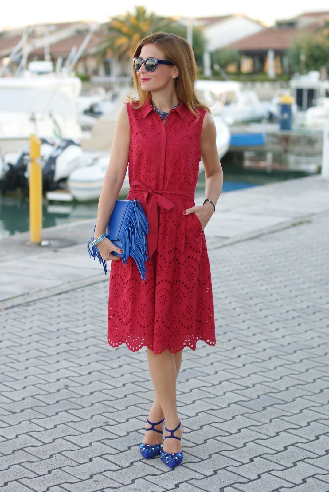 broderie anglaise dress and fringed clutch on Fashion and Cookies fashion blog, fashion blogger style