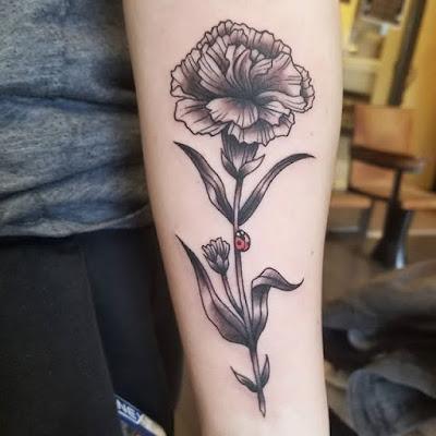 flower and ladybug tattoo