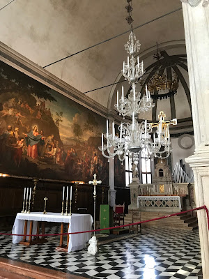 the church of st pietro martire lies at this intersection as well and dates to 1511 notice the enormous glass chandelier above i admit i thought id see a