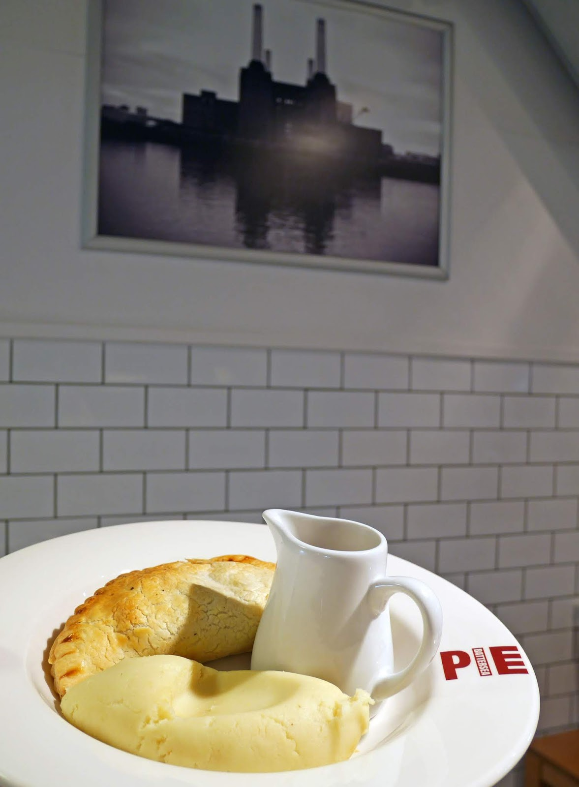 Vegetarian pasty with a side of mash potato at the Battersea Pie Station restaurant in Covent Garden, London