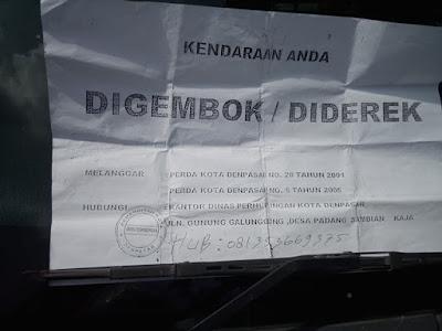 Surat tanda jika kendaraan digembok