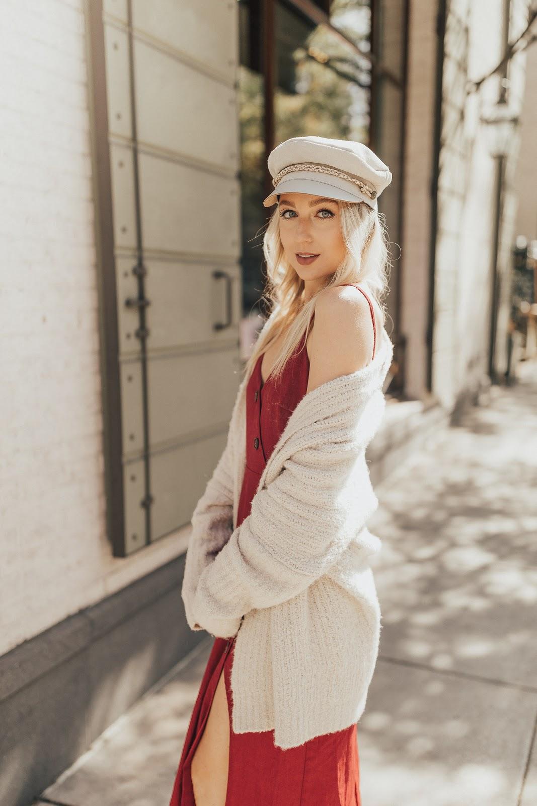 Sweater layered over a linen dress
