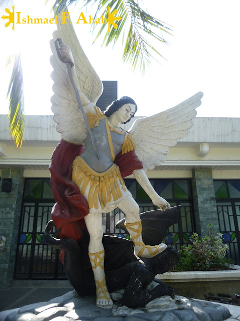 Image of Saint Michael slaying the devil in Saint Michael the Archangel Chapel, Fort Bonifacio