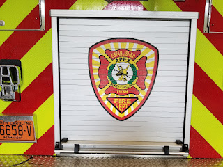 Apex firetruck with badge on the back