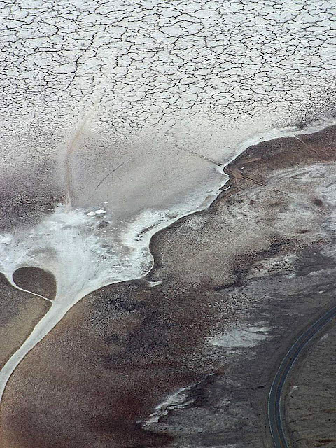 salt crystal plain and highway seen from aerial view