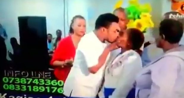 #TrendingVideo: Ghanaian Pastor giving a holy kiss to his sick female member.