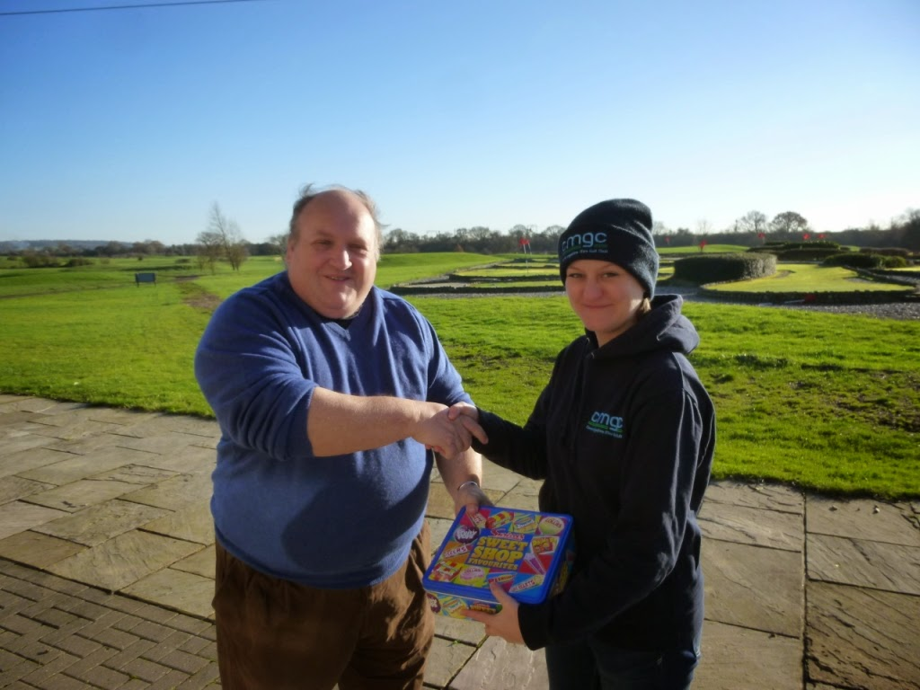 CEMGC Invitational Tournament winner Emily 'Lemony' Gottfried receives her prize from Mark 'The Natural' Wood at the Dunton Hills Family Golf Centre miniature golf course