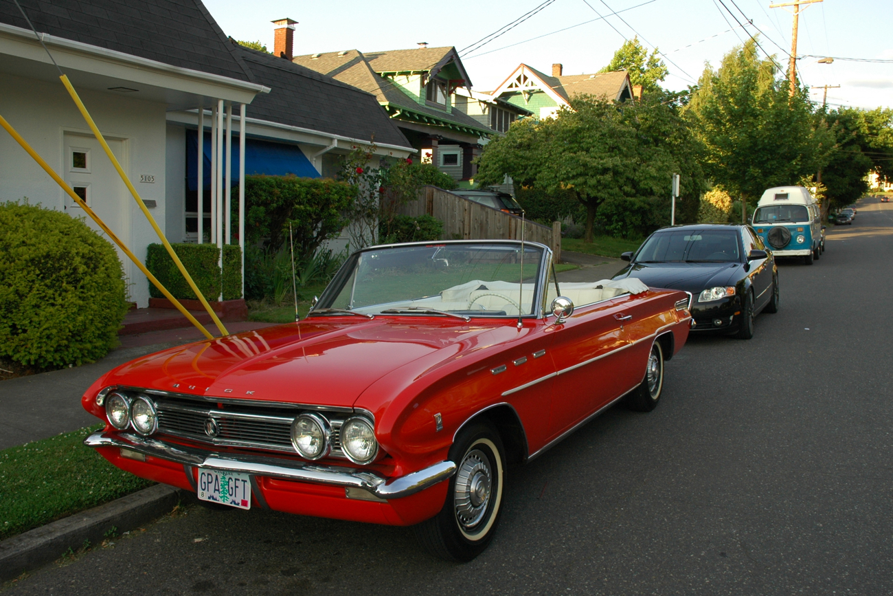 OLD PARKED CARS.: 1961 Buick Skylark Convertible.