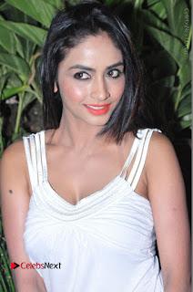 Actress Model Pooja Sri Stills in White Short Dress at F Club pre soft Launch  0131.JPG