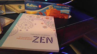 ZEN Coloring Book to Destress, with a box of Behlsen Choco Leibniz cookies on my desk.