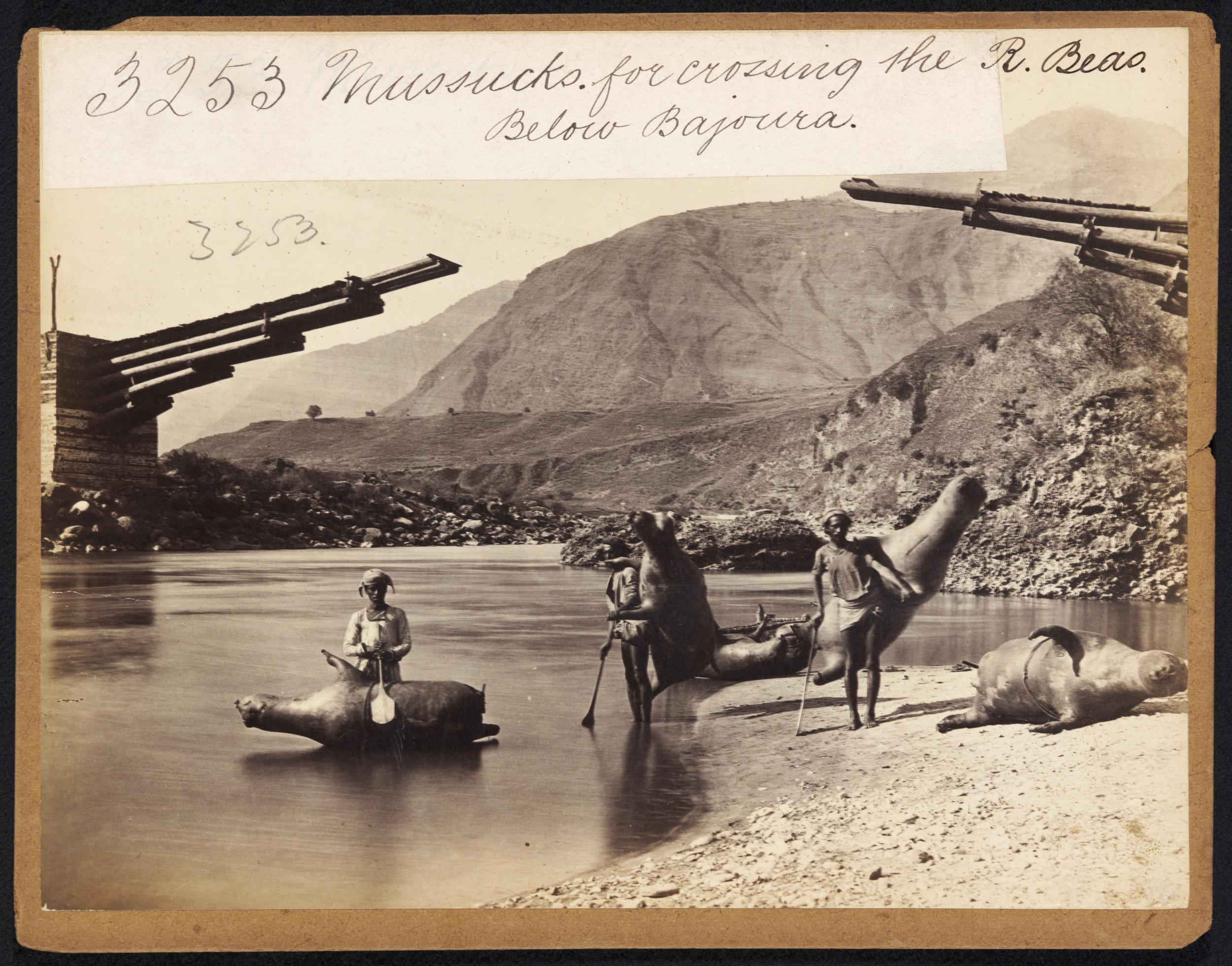 Mussucks (Inflated leather bag) carried by Men in a River - India, c1870's
