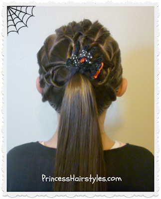Halloween hairstyles. Tangled weave spider web ponytail.