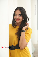 Actress Poojitha Stills in Yellow Short Dress at Darshakudu Movie Teaser Launch .COM 0100.JPG