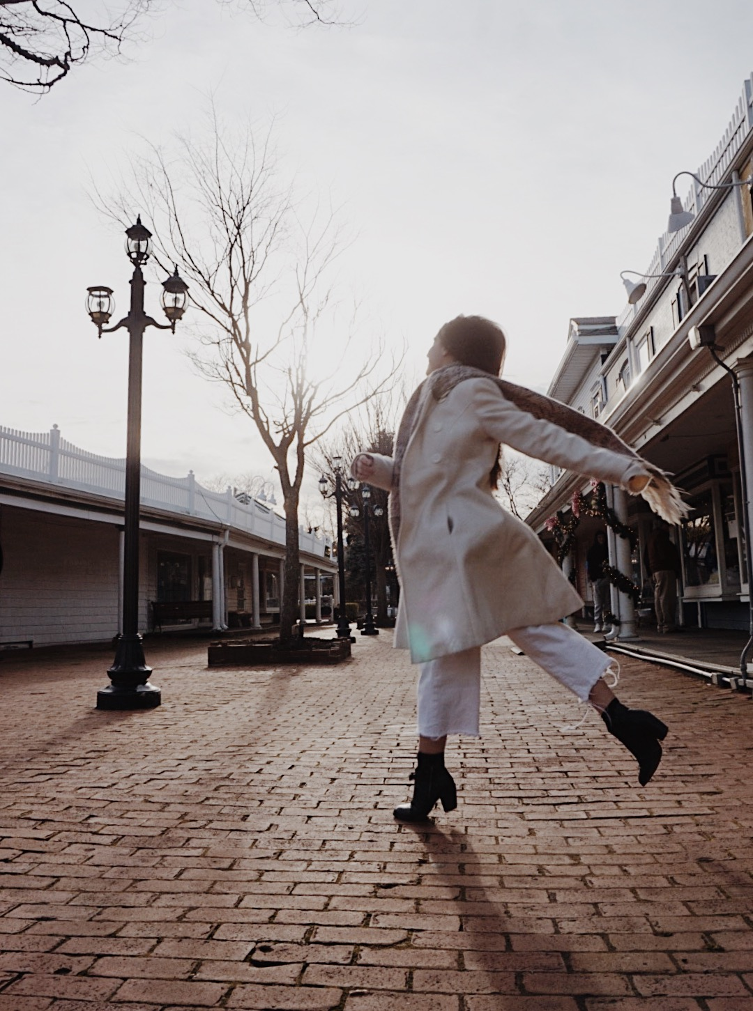 a girl dancing in a white winter outfit