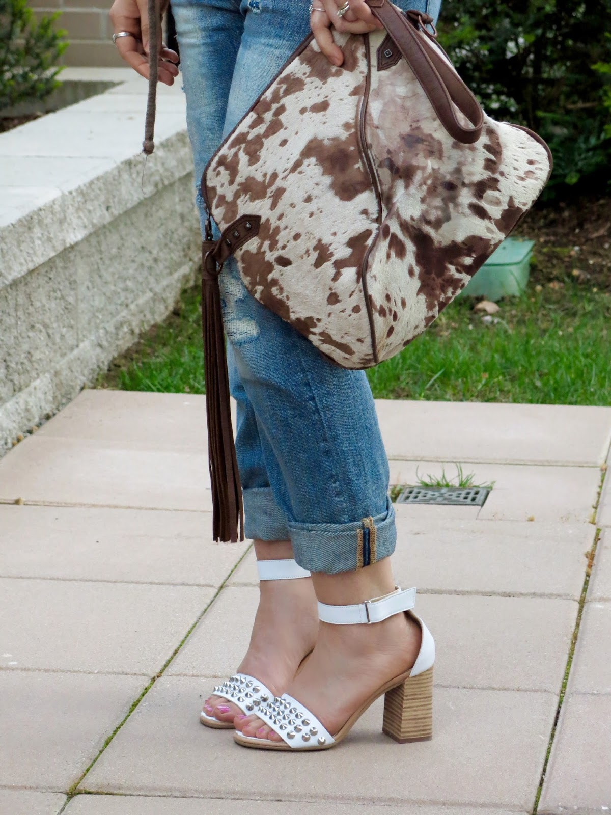 boyfriend jeans, studded ankle-strap sandals, pony-hair bag