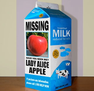 "A milk carton with a photo of a Lady Alice apple. The caption says, ""Missing"""