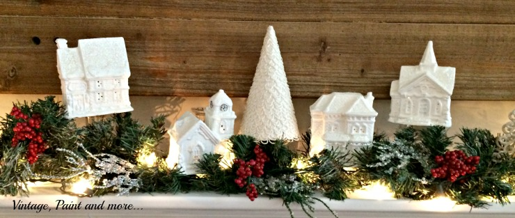 Vintage, Paint and more... Dollar Store village painted white on a snow themed mantel with pops of red color