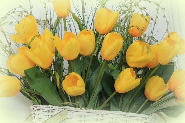 Pretty Spring door decoration with yellow tulips.