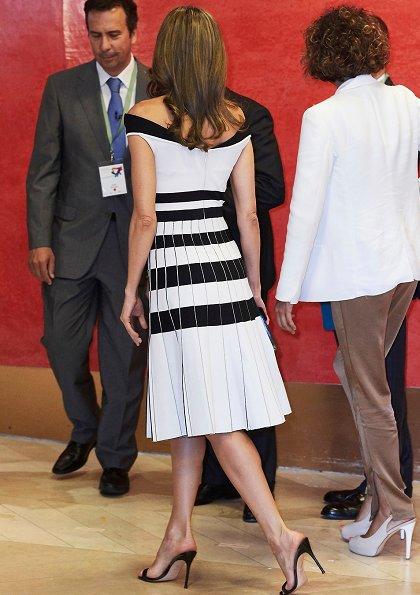 Queen Letizia wore Carolina Herrera Striped Off The Shoulder Knit Dress and Carolina Herrera sandals