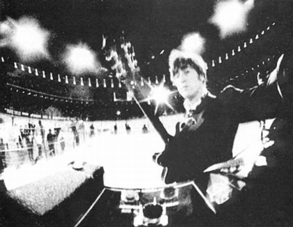 John Lennon setting up a camera at Candlestick park concert