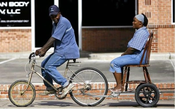 Funny African transportation bicycle passenger picture