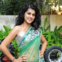 Glorious Tapsee cute in green saree