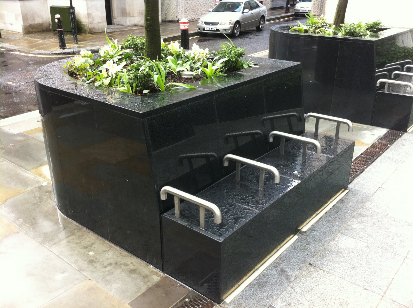 An Architectural Inspired Pocket Park With Some Modern Marble Benches