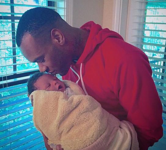 D'Prince Mavin Artist with Baby Boy