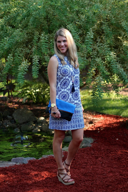 blue white china print dress, wedges, Clare V. clutch, tassel necklace