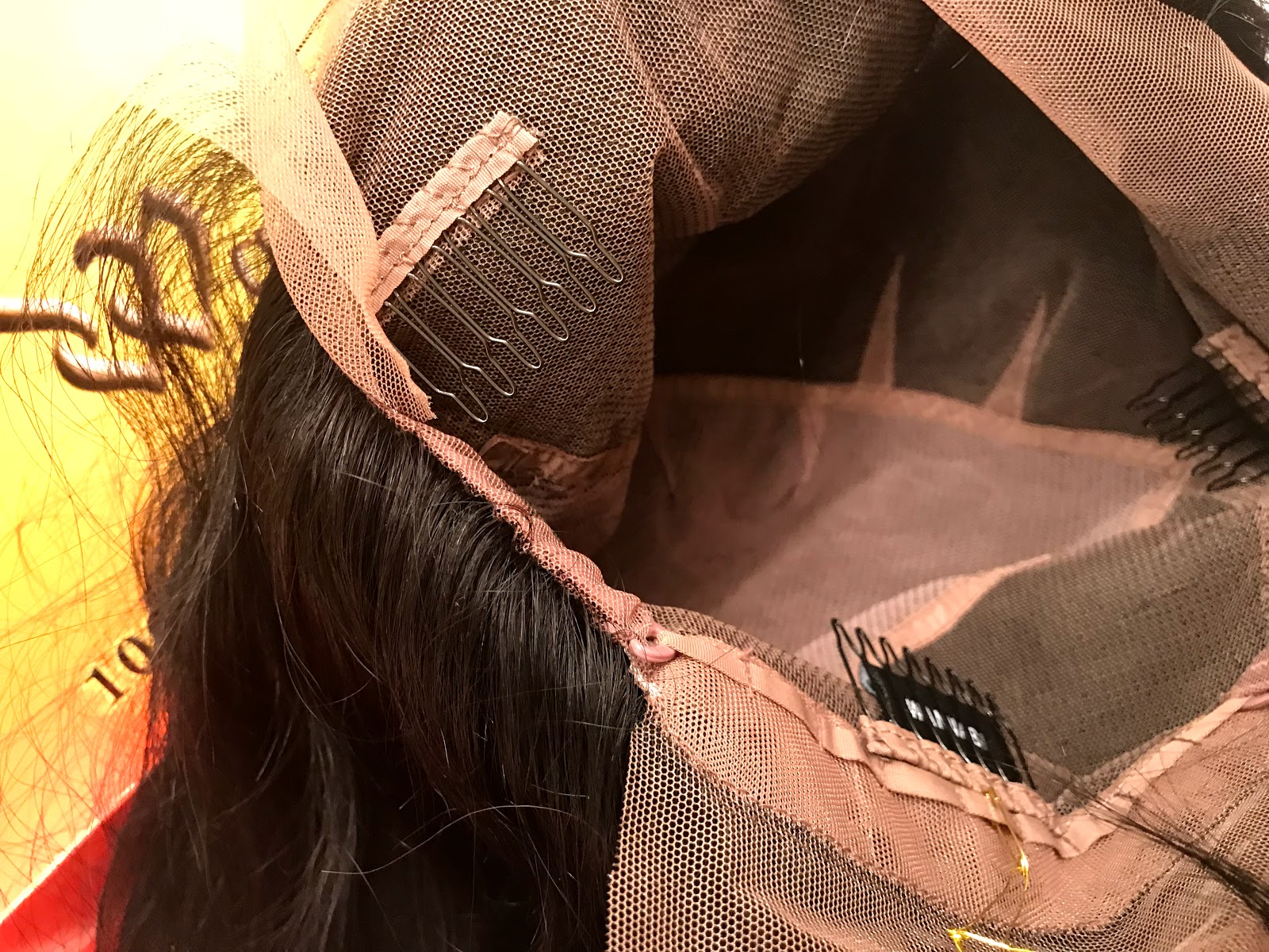 Image:The inside of the wig has four combs, one in the front and back, with one on each side of the ears. The best part was the cap is breathable and soft to the touch.