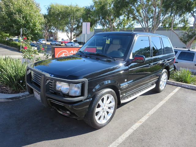 Range Rover after complete paint job at Almost Everything Auto Body.