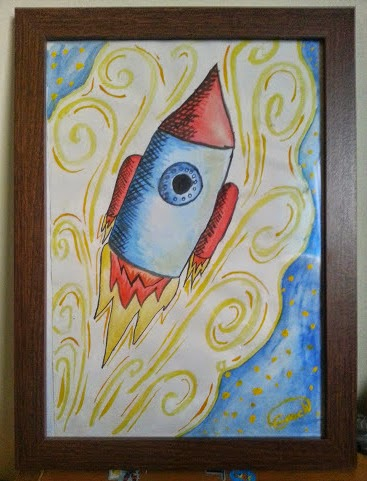 Elspeth's rocket. On the fridge for a year and now in a frame