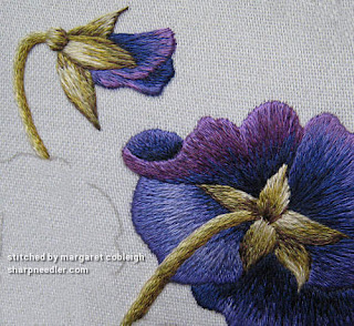 Detail of thread painted embroidered purple pansy flower and bud (Pansies designed by Trish Burr)