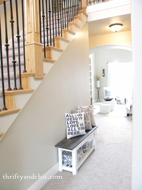 DIY board and batten staircase makeover. DIY stair makeover. How to hang board and batten on stairs. Staircase board and batten tutorial. Staircase ideas. Entry way decor and decorating ideas. Staircase decor and decorating ideas.