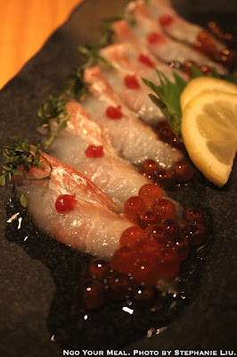 Fluke Carpaccio: Thinly Sliced Fluke Sashimi Drizzled with Olive Oil Topped with Plum Paste at Sakagura