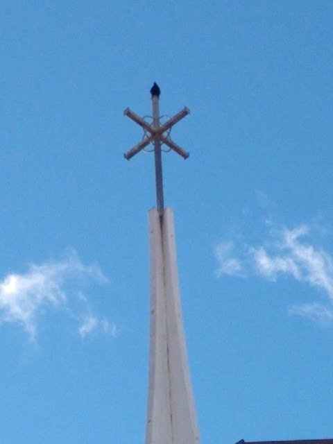 Crow sentry on a church cross