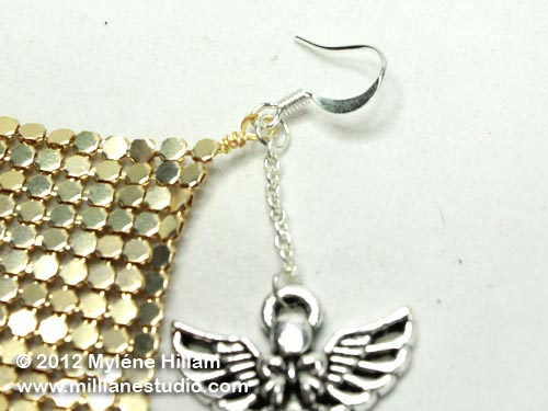 The angle charm has been attached to a length of chain and then to the earring wire.