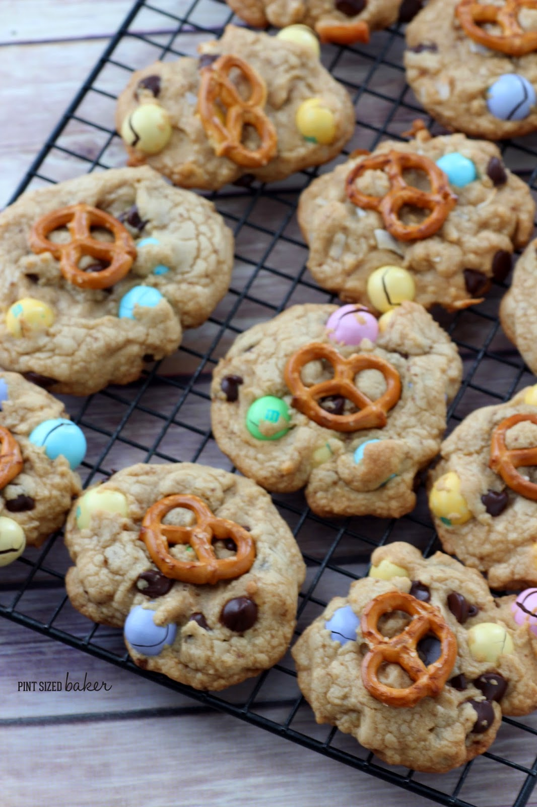 Love sweet and salty? You're gonna love these M and M Pretzel Chocolate Chip Cookies! Easy cookies with salty pretzel M&M's and a pretzel on top!