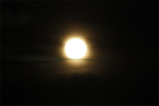 Super Moon Sits on A Cloud.