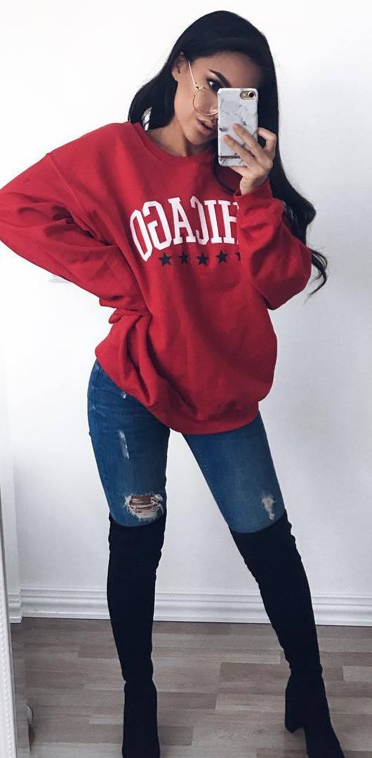 winter outfit idea / red printed sweatshirt + rips + black over knee boots