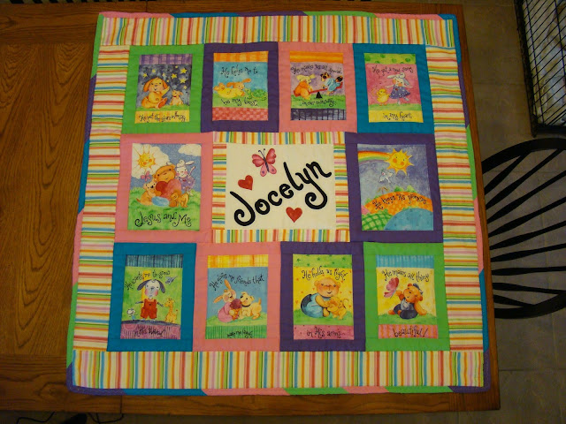 Baby quilt using fabric book panels