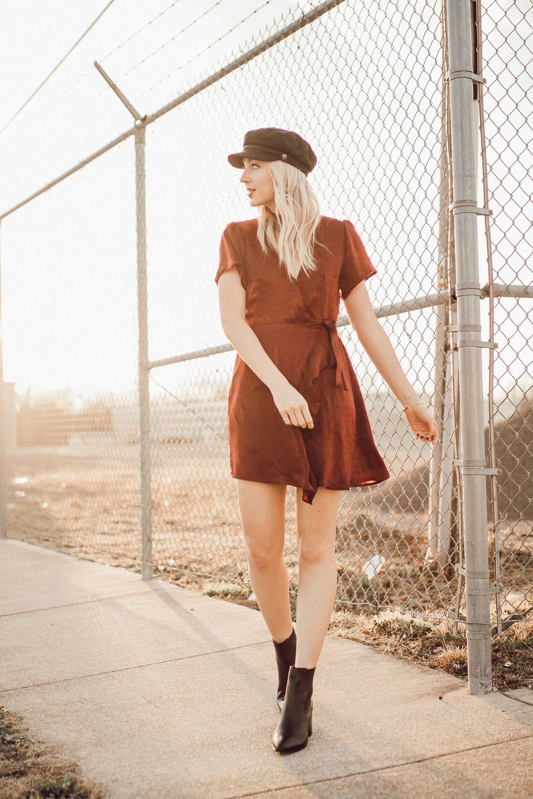 dressing down a satin dress with a hat + boots