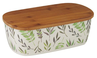white bread bin with pattern of leaves