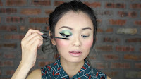 Sparkling Green New Year's Eve make up -Coat on few layer of mascara onto your own upper & lower lashes.