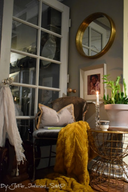 How to create a nook in a small living area;gold round mirror; mustard throw;french door divider;JoFer Interiors